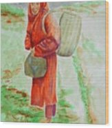 Bundled And Barefoot -- Portrait Of Old Asian Woman Outdoors Wood Print