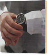 Businessman Looking At His Watch In Office Wood Print