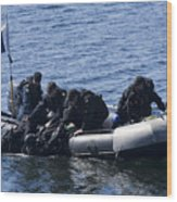 Canadian Divers Being Helped Aboard Wood Print