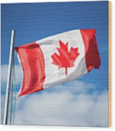 Canadian Flag Flying Proudly Wood Print