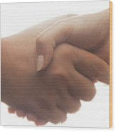 Candid Handshake On White Background. Strong Backlight Wood Print
