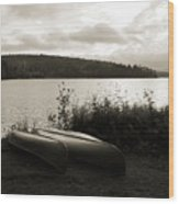 Canoe On A Shore Of A Lake At Dawn Wood Print