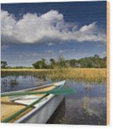 Canoeing In The Everglades Wood Print by Debra and Dave Vanderlaan