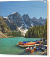 Canoes On A Jetty At  Moraine Lake In Banff National Park, Canada Wood Print