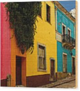 Casas In Pink Orange Yellow Blue Wood Print