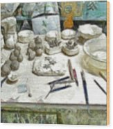 Ceramic Objects And Brushes On The Table Wood Print