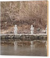 Cerubs On Icy Pond Wood Print
