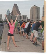 Cheerful Attractive Female Austinite Waves Her Hands With Excitement On Seeing The Austin Bats Wood Print