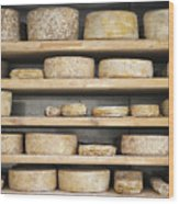 Cheese Wheels On Wooden Shelves In The Cheese Store Wood Print