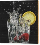 Cherries Splashing Into Sparkling Water Glass With Lemon Slice O Wood Print