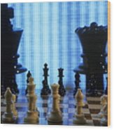 Chess Board With King And Queen Chess Pieces In Front Of Tv Scre Wood Print