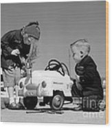 Children Play At Repairing Toy Car Wood Print