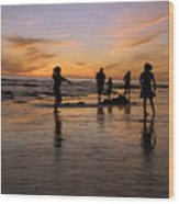 Children Playing On The Beach At Sunset Wood Print