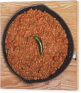 Chili In Black Pan On Wood Table With Jalapeno Pepper Wood Print