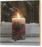Christmas Candle Glowing On Window Sill With Snowy Evergreen Bra Wood Print