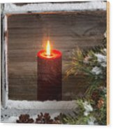 Christmas Red Candle With Snow Covered Home Window And Pine Tree Wood Print