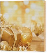 Christmas Scene With Gold Baubles And Gift On A Gold Background Wood Print