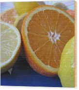 Citrus On Blue Plate Wood Print