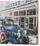 Classic Chevrolet Automobile Parked Outside The Store Wood Print