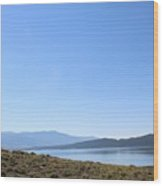 Clear Blue Skies Over Turquoise Lake Waters Wood Print