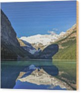 Clear Reflections In The Water At Lake Louise, Canada. Wood Print