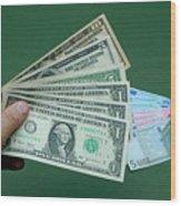 Close-up Of Man's Hand With Us Banknotes And Euro Banknotes Wood Print