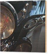 Close Up On Black Shining Car Round Light Wood Print
