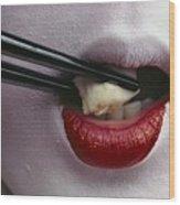 Close View Of A Geisha Eating Tofu Wood Print by Chris Johns