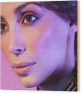 Closeup Beauty Portrait Of Woman Face In Colored Purple Light Wood Print