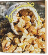 Closeup Of Walnuts Spilling From Small Bag Wood Print