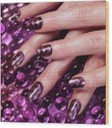 Closeup Of Woman Hands With Purple Nail Polish Wood Print