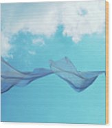 Cloth In The Wind Against The Blue Cloudy Sky. Wood Print