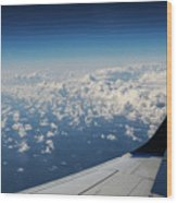 Clouds Under An Airplane Wing Wood Print