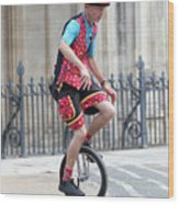 Clown Riding Unicycle In Town Wood Print
