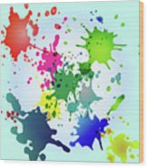 Colored Splashes On A Very Beautiful Blue Background Wood Print