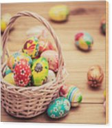 Colorful Hand Painted Easter Eggs In Basket And On Wood Wood Print