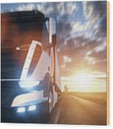 Commercial Cargo Delivery Truck With Trailer Driving On Highway At Sunset. Wood Print