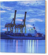 Container Cargo Freight Ship With Working Crane Bridge In Shipya Wood Print by Anek Suwannaphoom
