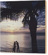 Couple Silhouetted On Beach Wood Print