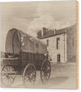 Covered Wagon And Stone Building Sepia Wood Print