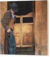 Cowboy By Saloon Doors Wood Print