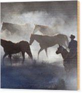 Cowboy Rounding Up Four Horses Wood Print
