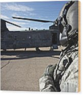 Crew Chief Of A Ch-47 Chinook Stands Wood Print