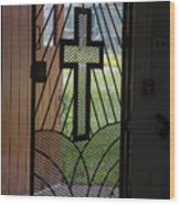 Cross On Church Door Open To Prison Yard Fence With Razor Wire Wood Print