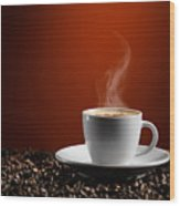 Cup Of Coffe Latte On Coffee Beans Wood Print