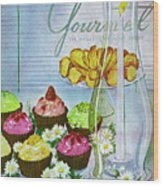 Cupcakes And Gaufrettes Beside A Candle Wood Print