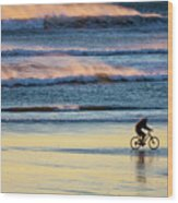 Cyclist Pedals Against The Wind At Pismo Beach Wood Print