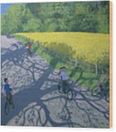 Cyclists And Yellow Field Wood Print