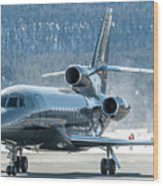 Dassault Falcon 900 Parking With Marshaller Wood Print
