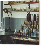 Desk With Bottles Of Chemicals Wood Print